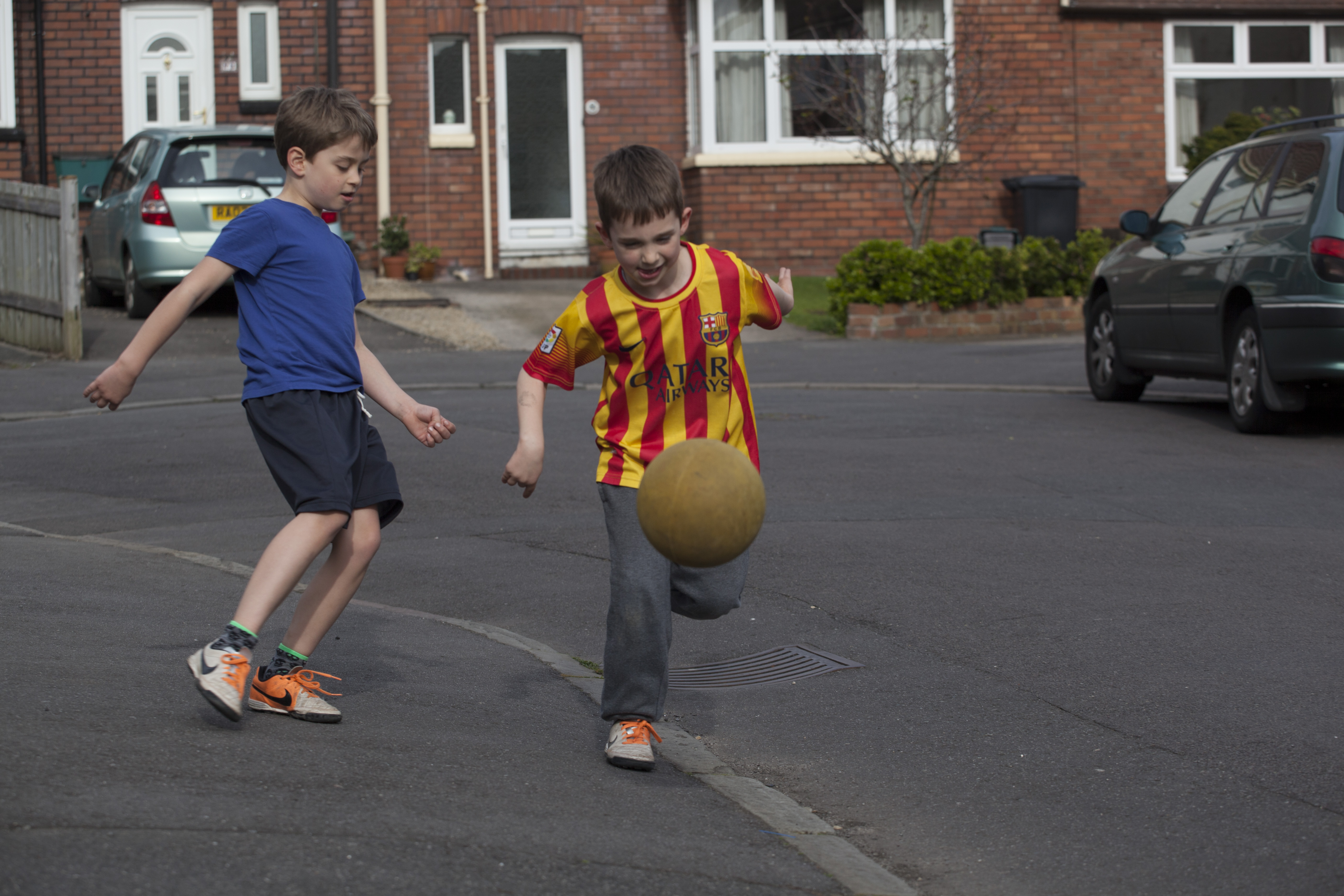 Playing football in the street