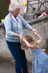 grandma and child jumping