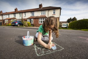 Girl chalking on street