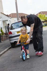 Dad helping child with cycling