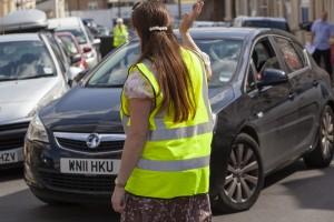 Steward-guiding-out-car-4