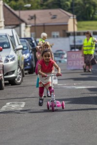 Girl scooting on play street
