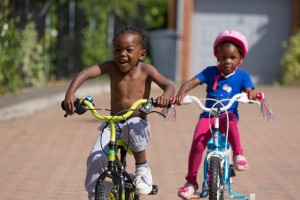 Two children cycling