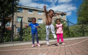 Three children skipping