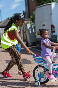 steward and child riding bike