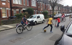 Cycling and football in the street