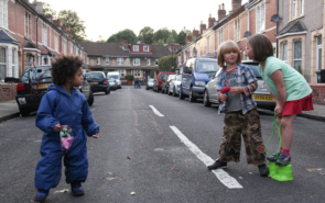 Children sharing snacks on a play street