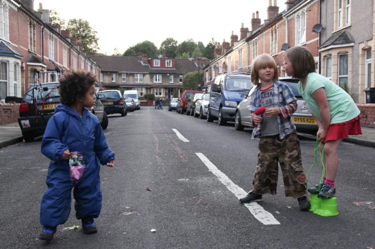 Children sharing snacks on a play street