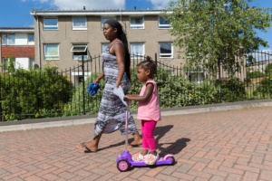 Parent and child playing out on housing estate