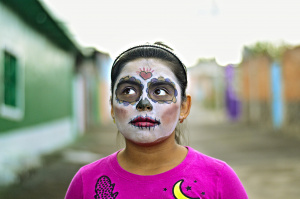 Young girl with Halloween face paint
