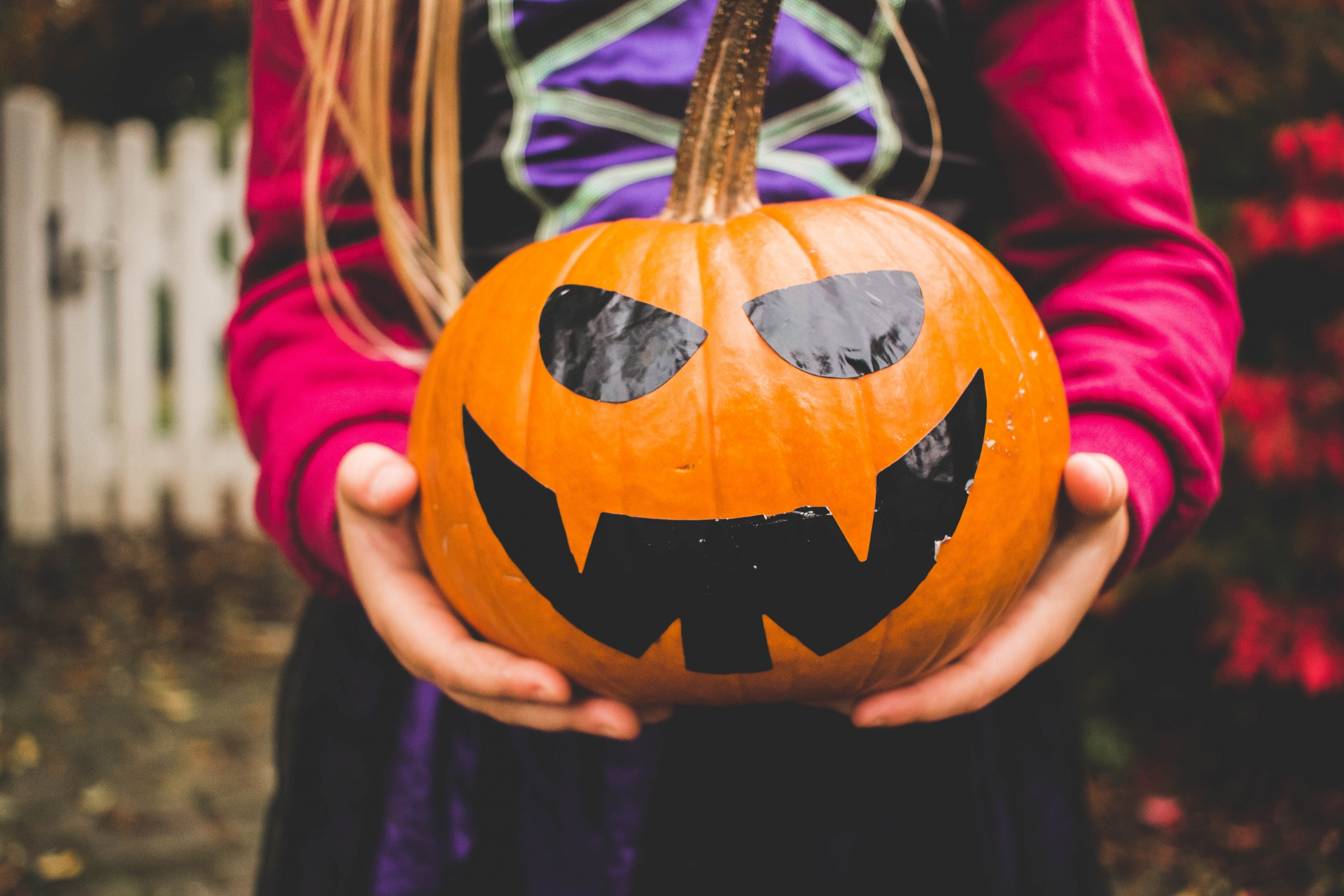 Child holding Halloween pumpkin