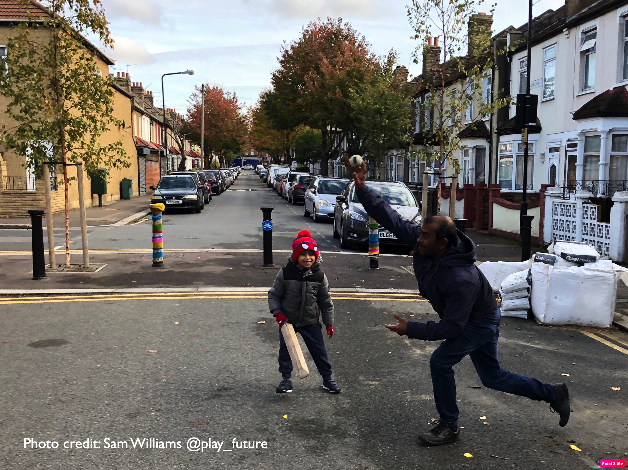 Playing cricket in the road