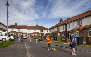Playing football in road